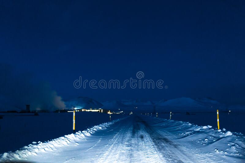 Picturesque winter landscape of Iceland. The perfect road to perspective.  stock photo