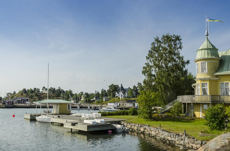 Picturesque yellow holliday houses Arkösund Sweden stock photos
