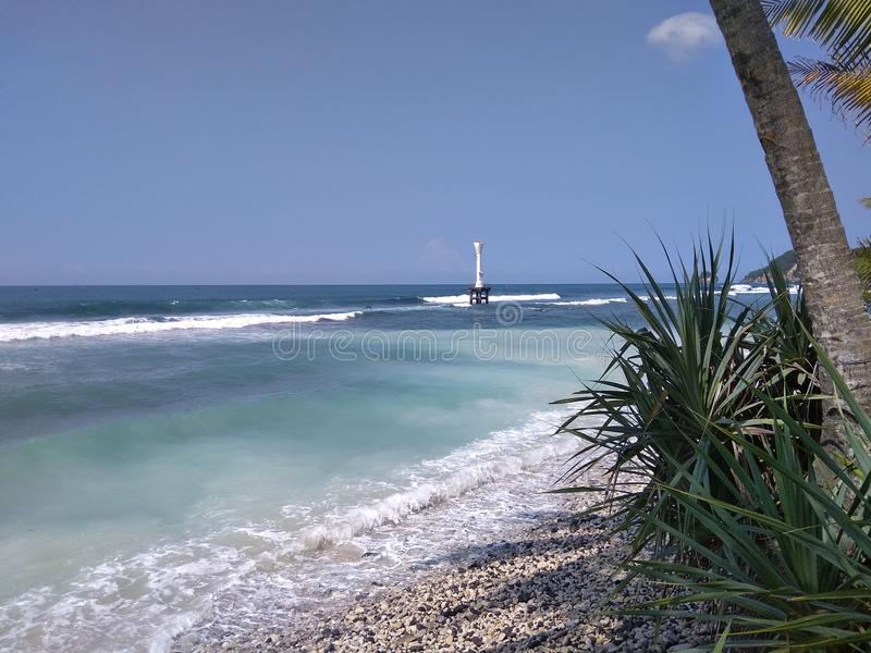Pidakan海滩美好的全景与灯塔的在天际 库存照片