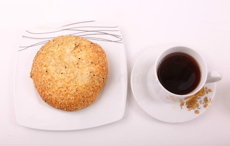 Tea with pie. Pie with cup of tea on modern white dish over white background royalty free stock photo