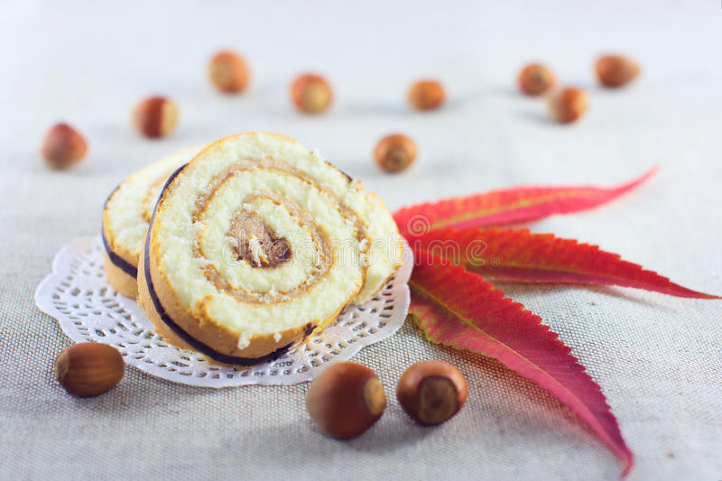 Pie decorated with nuts and autumn leaves royalty free stock image