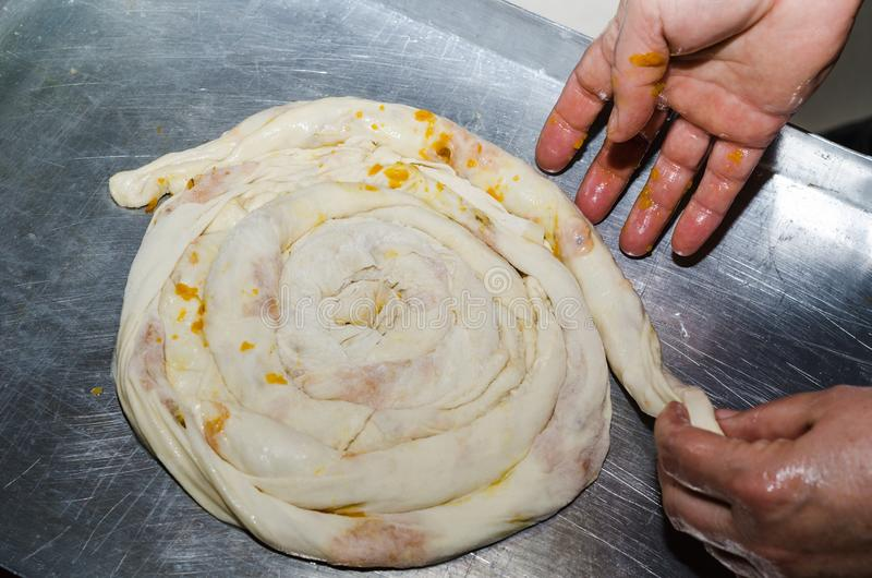 Pie dough is rolled, in the tray. royalty free stock image