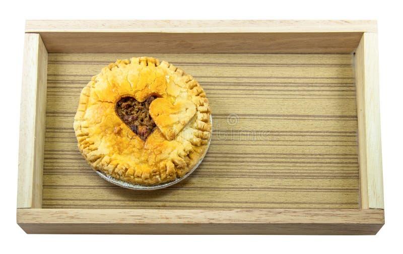 Pie heart shaped on wood box stock photos