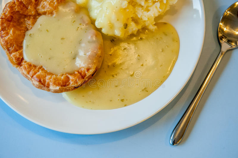 Pie, Mash and liquor. Traditional East end of London meal called Pie, Mash and liquor royalty free stock photo