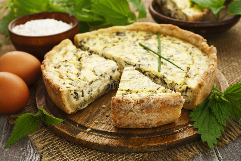 Pie with nettle. Spring onion and cottage cheese stock photo
