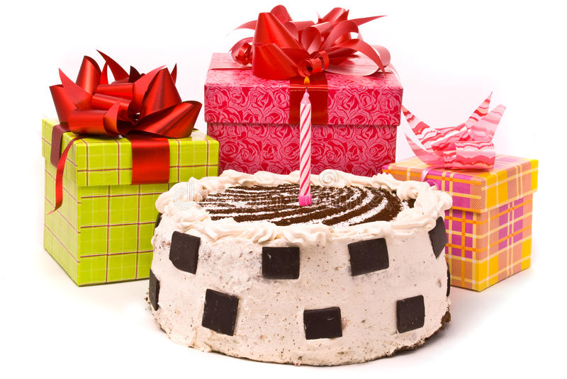 Pie with one candles and gifts in boxes royalty free stock images