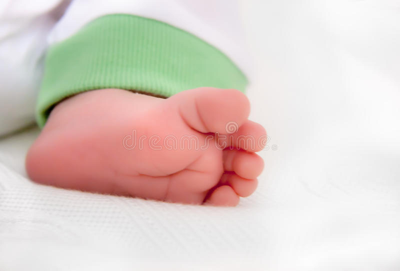 Pie recién nacido del bebé foto de archivo