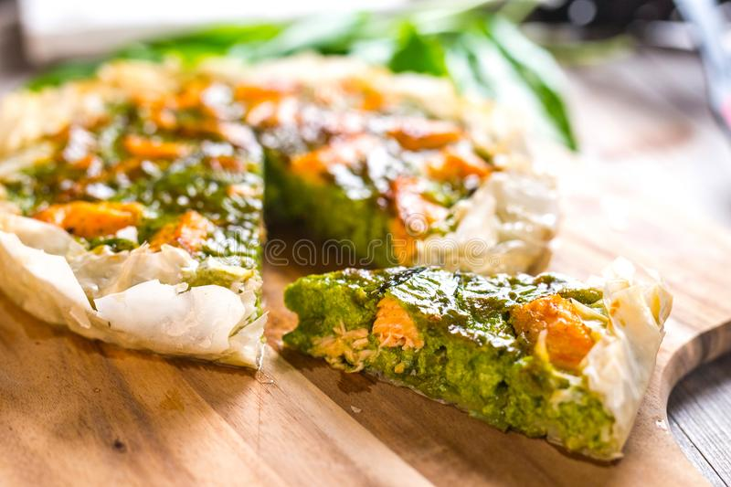 Pie with salmon. Ramson and soft cheese stock photography