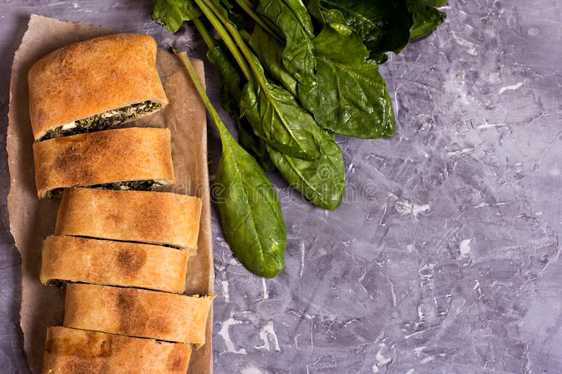 Pie with spinach, Fresh spinach and cheese royalty free stock image
