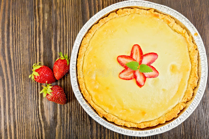 Pie strawberry with sour cream and berries on board top royalty free stock photo
