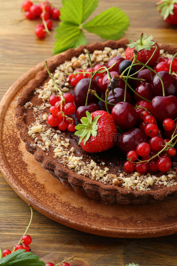 Pie with summer fruits on wood. Food close-up stock photography