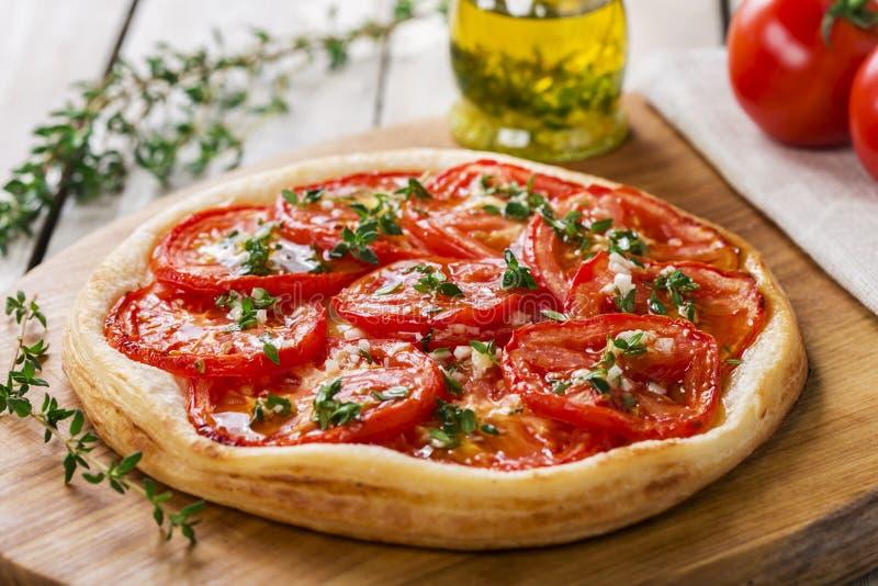 Pie with tomato tart royalty free stock image