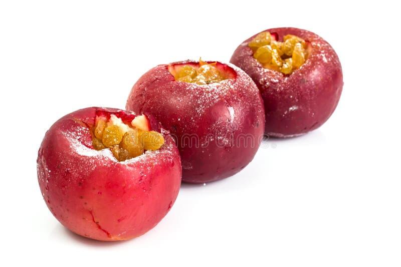 Piec jabłko z rodzynkami na białym tle fotografia stock