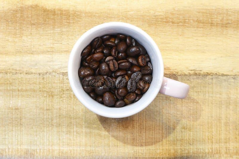 Piec kawowych fasoli zbliżenia tła kawy espresso czerni zbliżenie royalty ilustracja