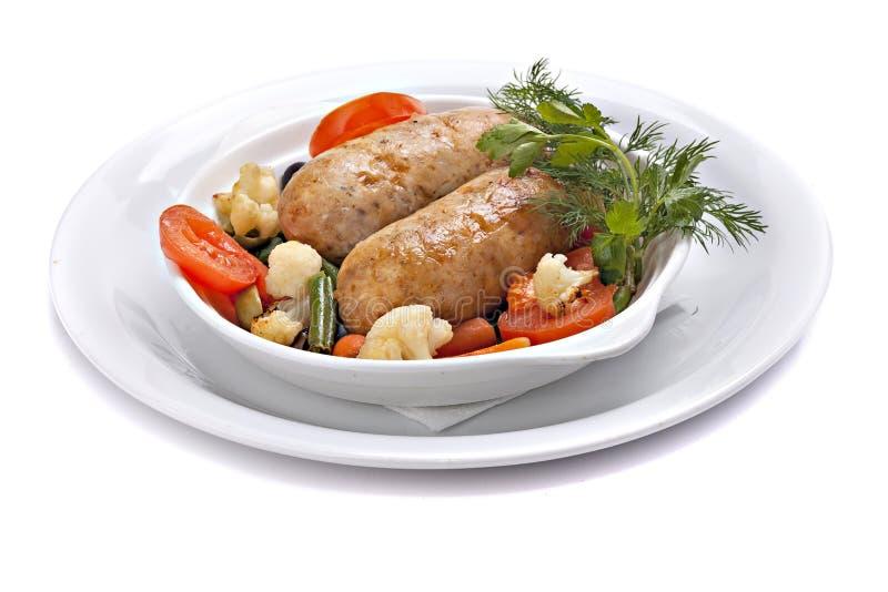 Piec kiełbasa z warzywami w pucharze zdjęcie stock