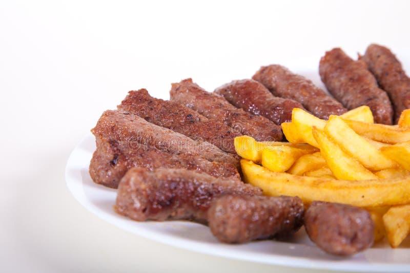 Piec na grillu naczynie minced mięsny cevapcici fotografia royalty free