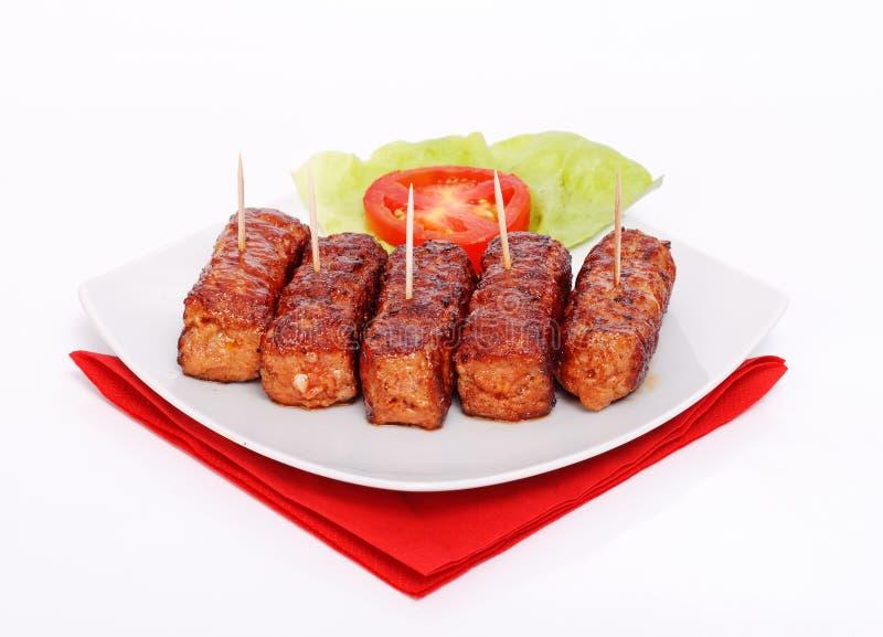 Piec na grillu romanian mięsne rolki - mititei, mici fotografia stock