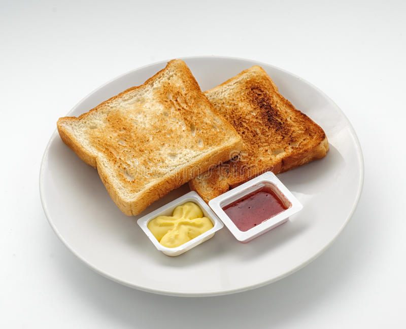Piec plasterki chleb z dżemem i masłem obrazy stock
