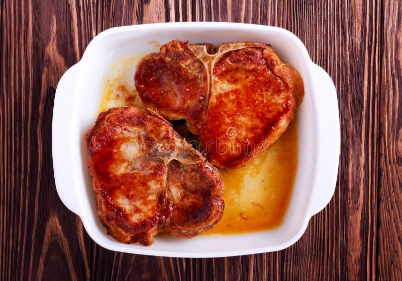 Piec wieprzowina kotleciki na kości zdjęcia royalty free