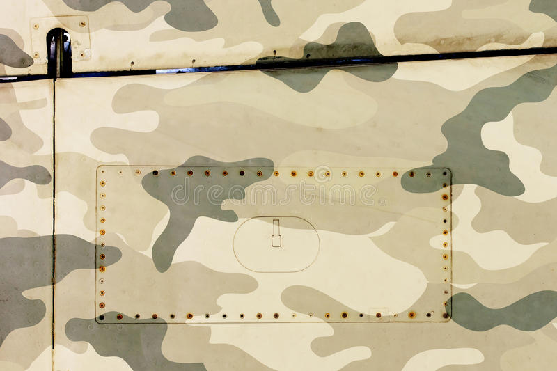 Piece of aircraft grunge metal background, army camo royalty free stock image