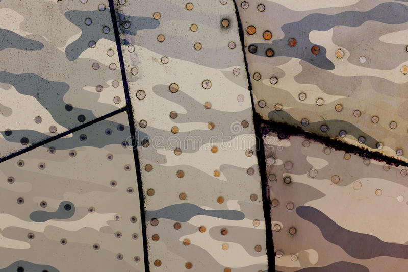 Piece of aircraft grunge metal background, army camo. Old and worn stock photography