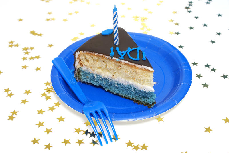 Piece of Birthday Cake. A piece of the birthday cake surrounded by star confetti stock photo