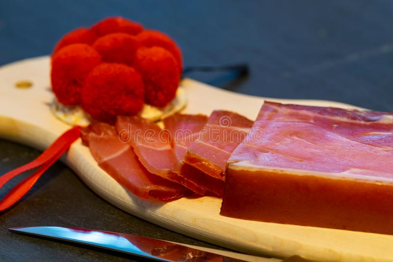 A piece of Black Forest ham on a board stock images