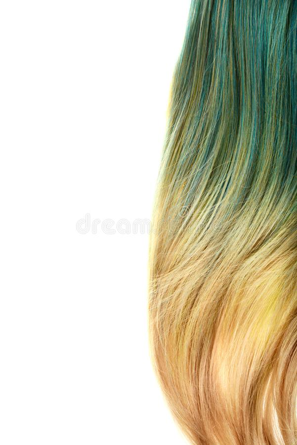 Piece of blond and blue umbra hair stock photo