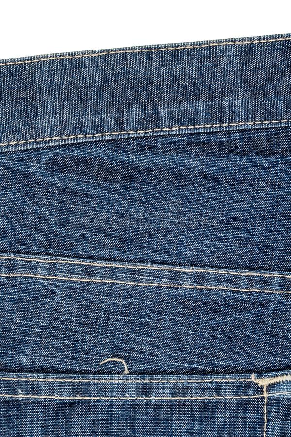 Piece of blue jeans fabric stock image