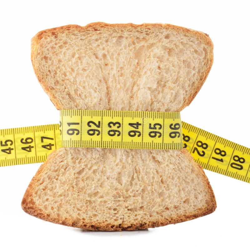 Download Piece Of Bread Grasped By Measuring Tape Stock Image - Image: 25926253