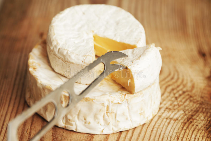 A piece of Brie cheese stock image