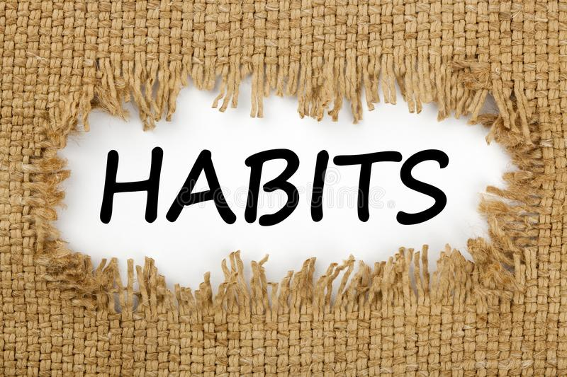 Habits written in hole on the burlap royalty free stock photos