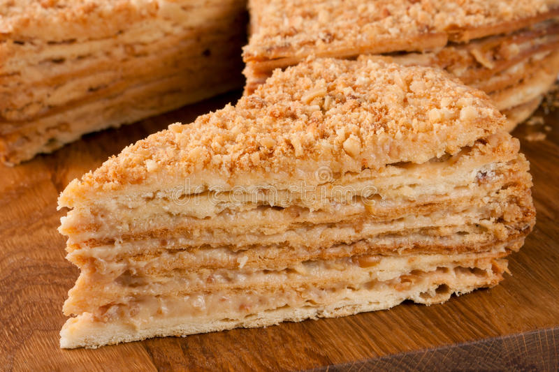 Download Piece Of Cake Napoleon Close Up On A Wooden Board Stock Photo - Image: 83719028