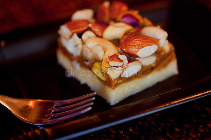 Piece of cake with nuts stock photos