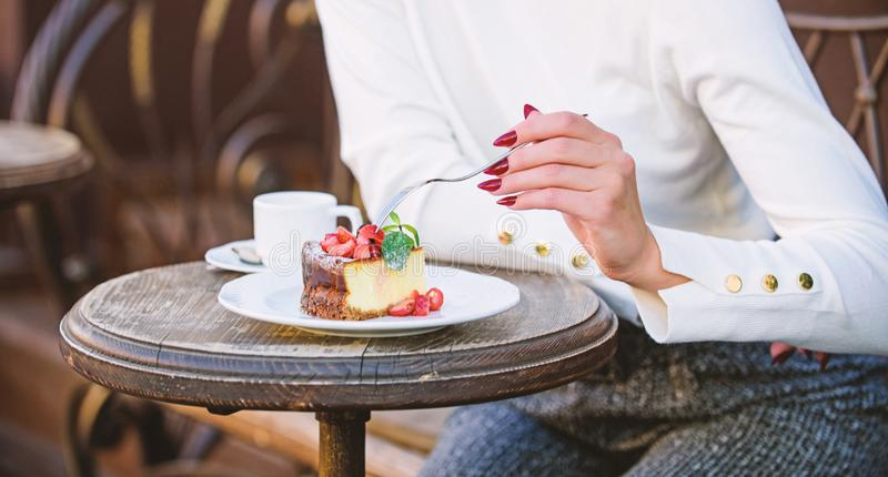 Piece of cake with red berry. Gourmet recipe food. Cake slice on white plate. Cake with cream delicious dessert. Appetite concept. Dessert cake cup of coffee stock photo