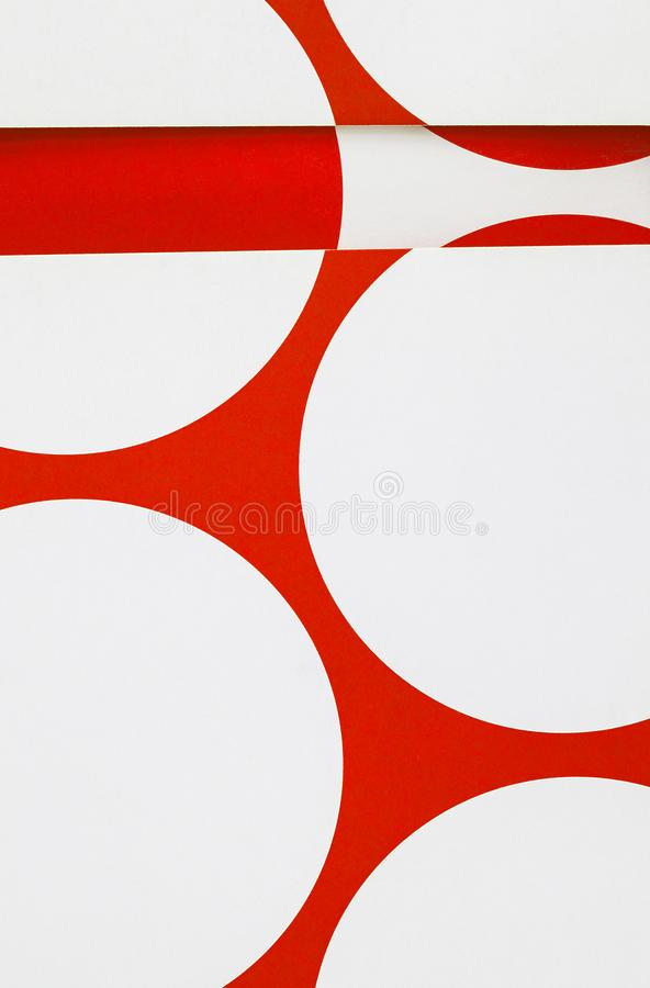 A close up of paper with cut printed circles. stock photography