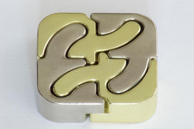 Cast iron puzzle 4 piece cube gold nad silver royalty free stock photography