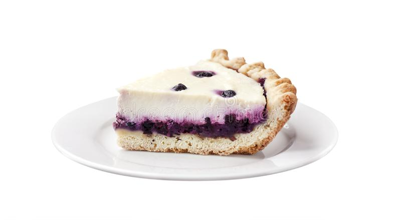 Piece of cheesecake with blueberries on a plate isolated royalty free stock images