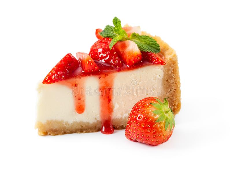Piece of cheesecake with fresh strawberries and mint isolated on stock photo