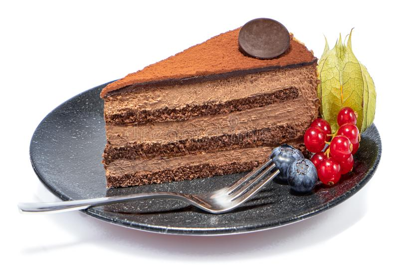 Piece of chocolate cake on a black plate royalty free stock photos