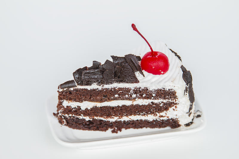 Piece of chocolate cake. With cream and cherry royalty free stock photography