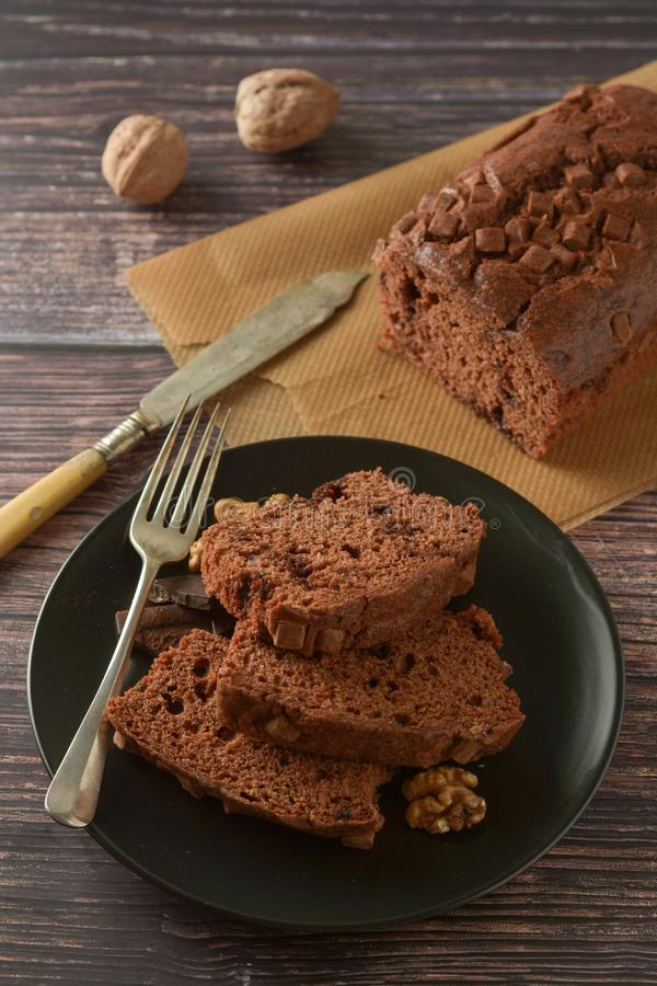 Piece of chocolate cake , fudge or pound cake. Wooden background royalty free stock images