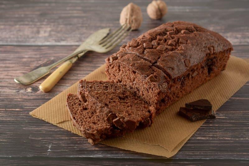 Piece of chocolate cake , fudge or pound cake. Wooden background royalty free stock photos