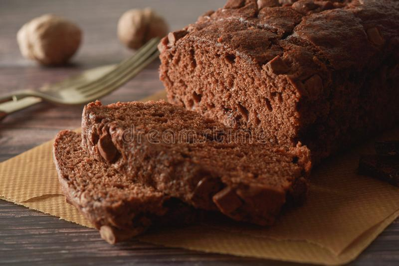 Piece of chocolate cake , fudge or pound cake. Wooden background royalty free stock image