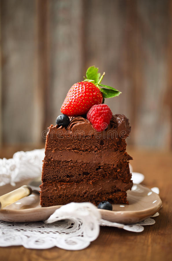 Download Piece Of Chocolate Cake With Icing And Fresh Berry Stock Image - Image: 28534217