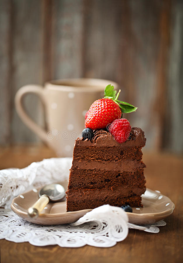 Download Piece Of Chocolate Cake With Icing And Fresh Berry Stock Image - Image of gourmet, coffee: 28534557