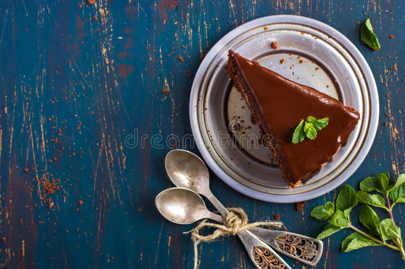 Piece of chocolate cake with mint leaves. Top view royalty free stock image