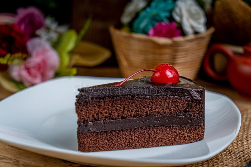 Chocolate cake with red cherry royalty free stock images