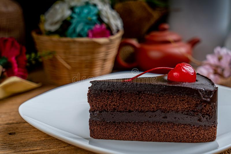 Chocolate cake with red cherry royalty free stock image
