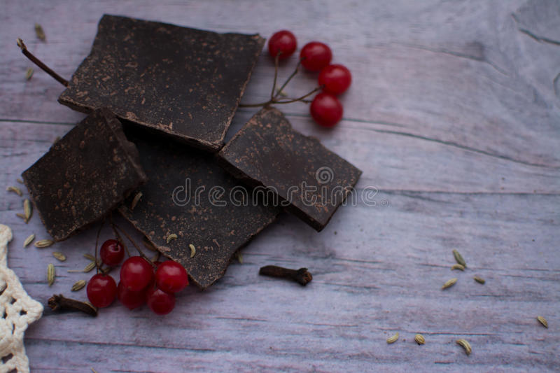 A piece of chocolate and cranberry on a gray table stock photography